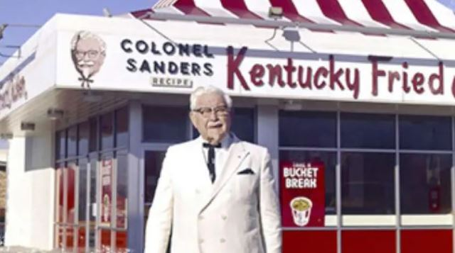 Colonel Sanders in front of the First KFC Franchise Location